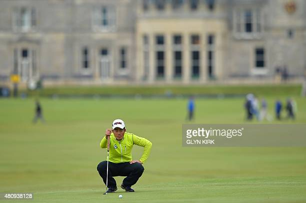 China's Liang WenChong line's up his putt on the 17th green during his first round 80 on the opening day of the 2015 British Open Golf Championship...