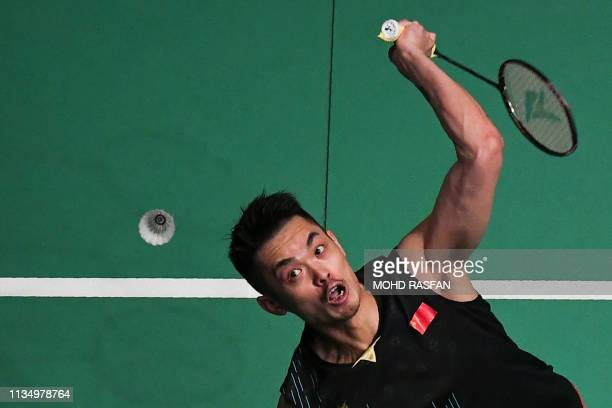 China's Lin Dan hits a return against Japan's Kanta Tsuneyama during their men's singles quarterfinal match at the Malaysia Open badminton tournament...