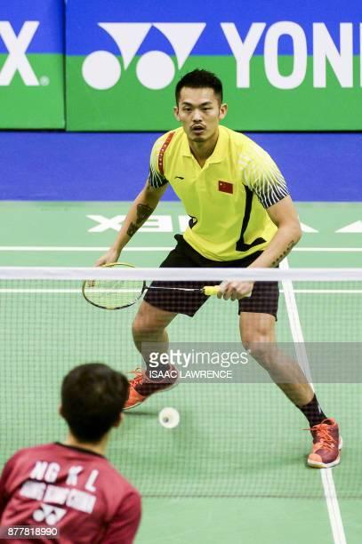 China's Lin Dan hits a shot against Hong Kong's Ng Ka Long Angus during their quarterfinal men's singles match at the Hong Kong Open badminton...