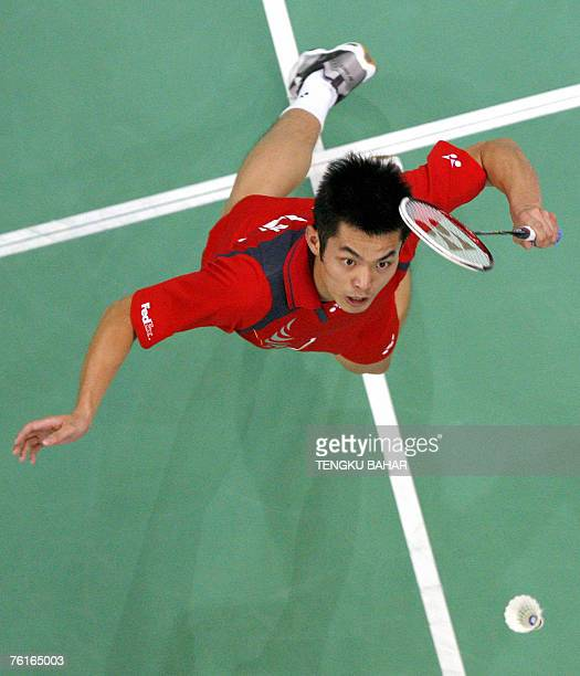China's Lin Dan prepares for a smash against compatriot Bao Chunlai during their men's singles semifinals match at the World Badminton Championships...