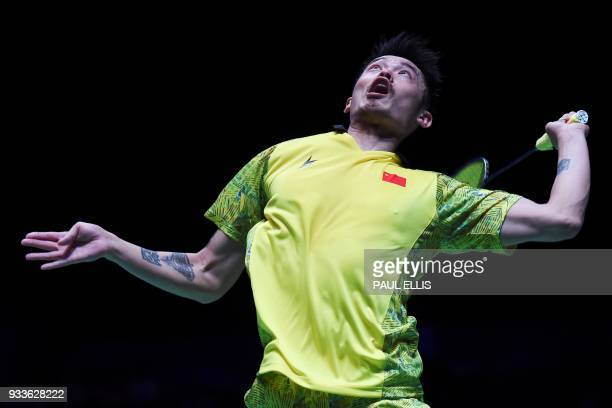 China's Lin Dan returns against China's Shi Yuqi in the men's singles final at the All England Open Badminton Championships in Birmingham central...
