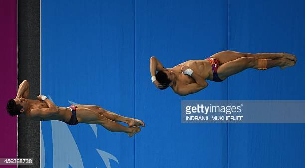 China's Lin Yue and Cao Yuan perform during the men's synchronised 3m springboard diving of the 2014 Asian Games at the Munhak Park Taehwan Aquatics...