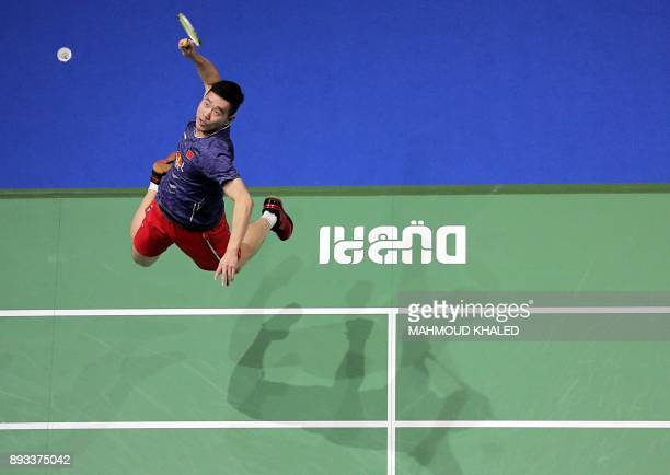 TOPSHOT China's Liu Cheng returns the shot to Denmark's Mathias Boe and Carsten Mogensen during the third day of the Dubai Badminton World...