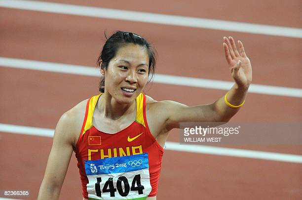 China's Liu Haili waves to supporters after winning the women's Heptathlon 200m heats at the National stadium as part of the 2008 Beijing Olympic...