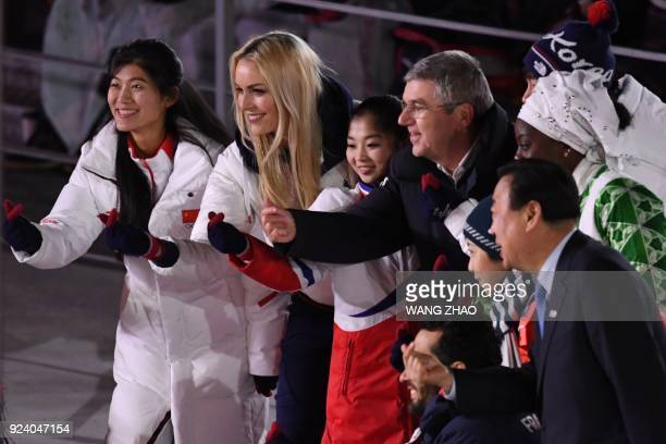 China's Liu Jiayu USA's Lindsey Vonn North Korea's Kim Ju Sik International Olympic Committee president Thomas Bach France's Martin Fourcade and...