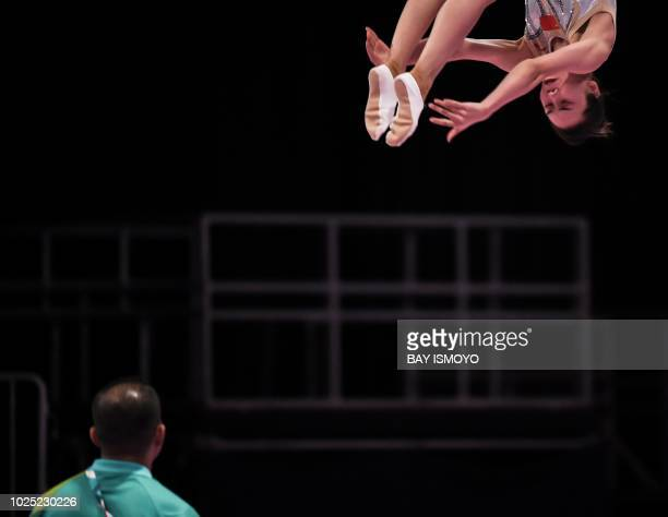 China's Liu Lingling competes in the women trampoline gymnastics final at the 2018 Asian Games in Jakarta on August 30 2018