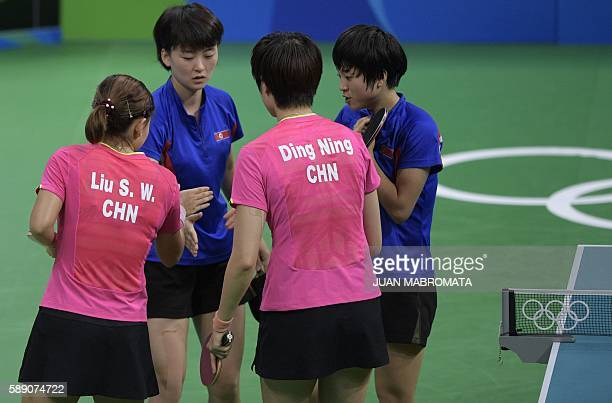 China's Liu Shiwen and Ding Ning greet North Korea's Ri Myong Sun and North Korea's Kim Song I after their women's team quarterfinal table tennis...