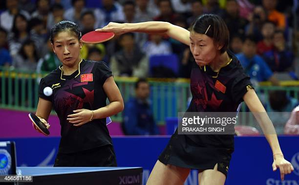China's Liu Shiwen and Wu Yang compete against North Korea's Kim Jong and Kim Hysong in the table tennis women's doubles semifinals match 1 during...