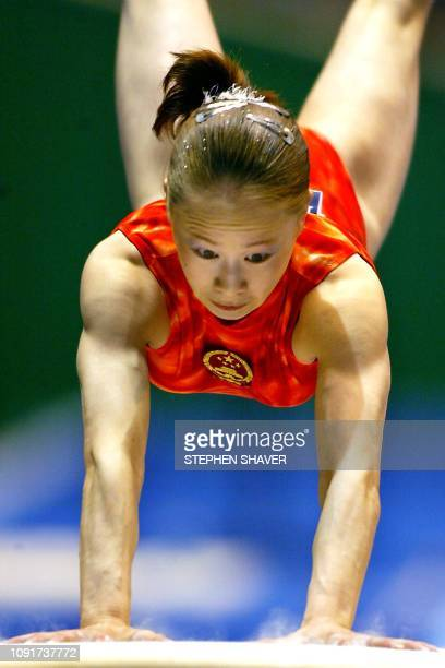 China's Liu Wei performs on the vault during the women's apparatus finals for the 14th Asian Games in Busan 04 October 2002 Liu won silver with a...