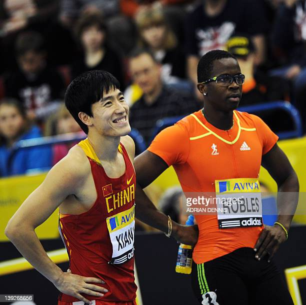 China's Liu Xiang smiles alongside Dayron Robles of Cuba after winning the men's 60 meter hurdles final during the Aviva Grand Prix athletics meeting...
