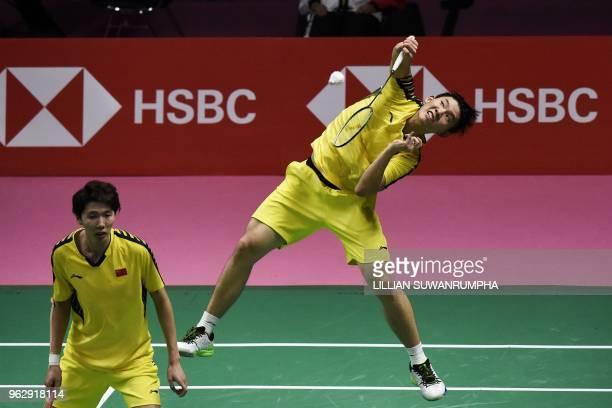 China's Liu Yuchen hits a return against Japan's Yuta Watanabe and Keigo Sonoda as his teammate Li Junhui looks on during their mens double final...
