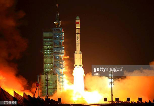China's Long March 2F rocket carrying the Tiangong1 module or Heavenly Palace blasts off from the Jiuquan launch centre in Gansu province on...