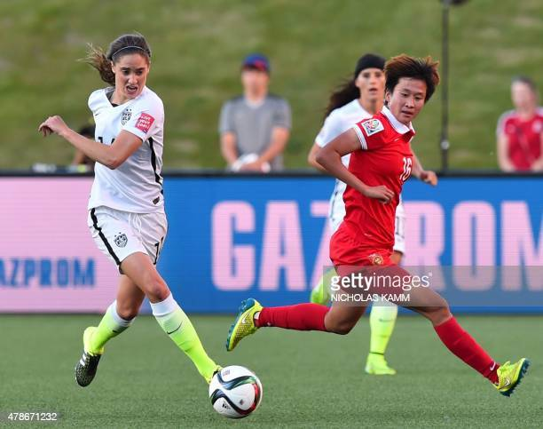 China's Lou Jiahui and US player Morgan Brian vie for the ball during a 2015 FIFA Women's World Cup quarterfinal match between the US and China at...