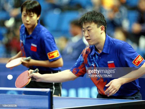 China's Ma Lin returns the ball against the Hong Kong pair of Ko Lai-Chak and Lau Sui-Fei during their mixed doubles quarter-finals match at the 14th...