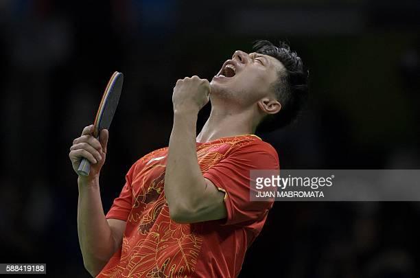 China's Ma Long celebrates beating Japan's Jun Mizutani in their men's singles semi-final table tennis match at the Riocentro venue during the Rio...