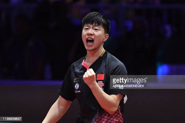 China's Ma Long celebrates his victory over Sweden's Mattias Falck on April 28 2019 after their men's single final at the ITTF World Table Tennis...