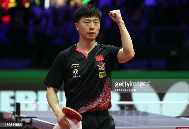 China's Ma Long celebrates winning against China's Liang Jingkun on April 27, 2019 during their men's single semifinal at the ITTF World Table Tennis...