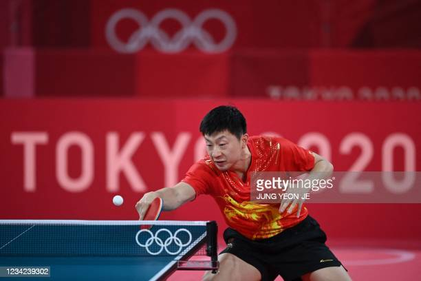 China's Ma Long competes against France's Simon Gauzy during his men's singles round of 16 table tennis match at the Tokyo Metropolitan Gymnasium...