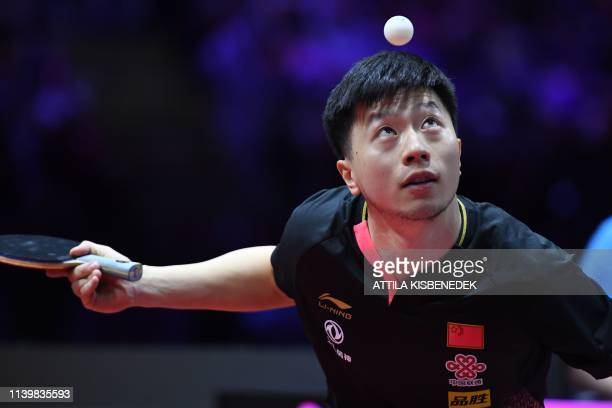 China's Ma Long eyes the ball as he serves to Sweden's Mattias Falck on April 28, 2019 during their men's single final at the ITTF World Table Tennis...