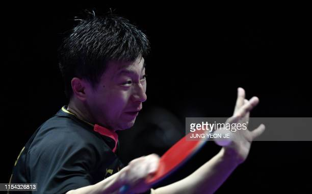 China's Ma Long hits a return against compatriot Xu Xin during the men's singles final match at 2019 ITTF World Tour Korea Open table tennis...