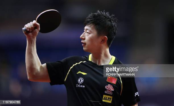 China's Ma Long jubilates during his men's single round of 16 table tennis match against China's Xu Chenhao at the 2020 ITTF World Tour Platinum in...