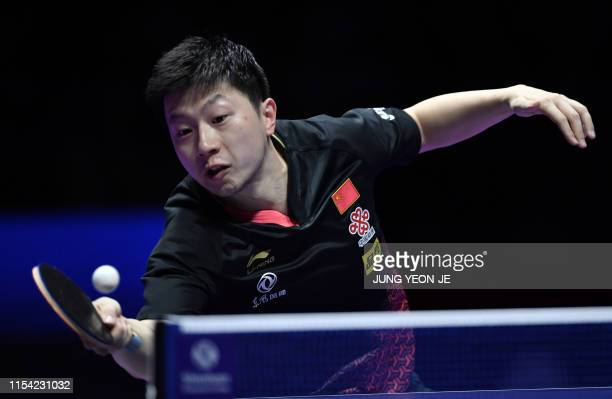 China's Ma Long returns the ball in the men's singles table tennis semifinal match against South Korea's Jeoung Young-sik during the 2019 ITTF World...