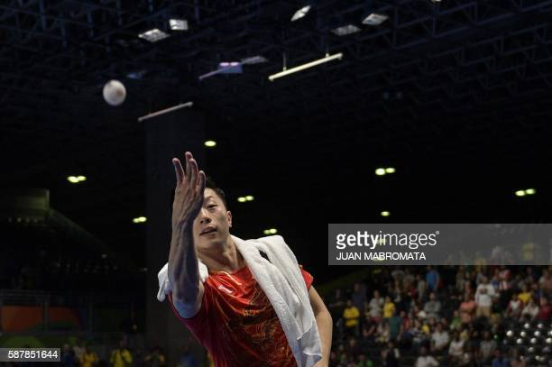 TOPSHOT China's Ma Long throws a ball into the crowd after beating Nigeria's Quadri Aruna in their men's singles quarterfinal table tennis match at...