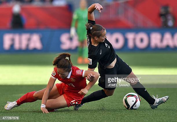 China's midfielder Tang Jiali and New Zealand's defender Ria Percival vie for the ball during their Group A football match of the 2015 FIFA Women's...