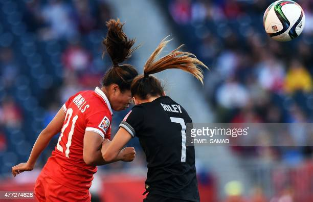 China's midfielder Wang Lisi and New Zealand's defender Ali Riley vie for the ball during their Group A football match of the 2015 FIFA Women's World...