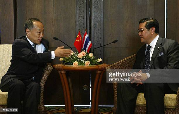 China's Minister of Foreign Affairs Li Zhaoxing speaks to his Thai counterpart Dr Surakiart Sathirathai at The Ministerial Meeting on Regional...