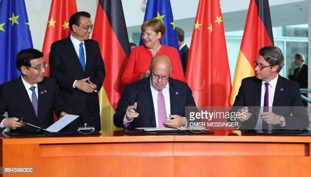 China's Minister of Industry and Information Technology Miao Wei, German Economy Minister Peter Altmaier and German Transport Minister Andreas...
