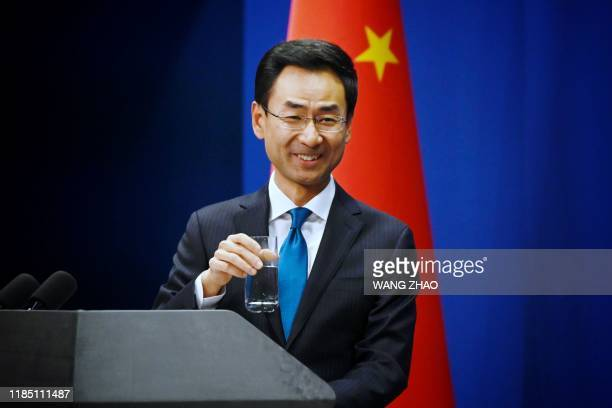 China's Ministry of Foreign Affairs spokesman Geng Shuang gestures before answering a question during a briefing in Beijing on November 28 2019...