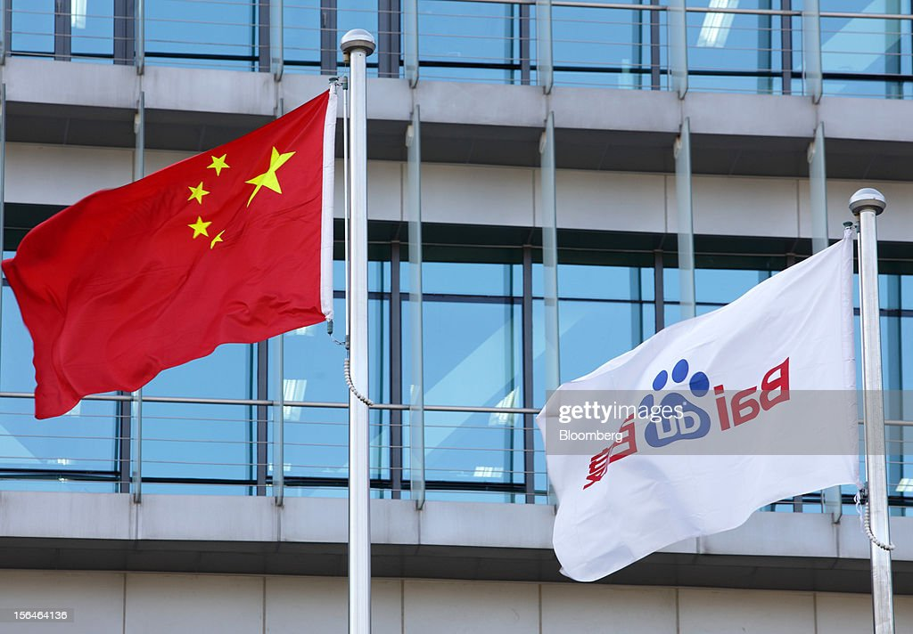 China's national flag, left, and Baidu Inc.'s corporate flag fly outside Baidu's headquarters in Beijing, China, on Monday, Nov. 12, 2012. Baidu is the owner of China's most-used search-engine. Photographer: Tomohiro Ohsumi/Bloomberg via Getty Images