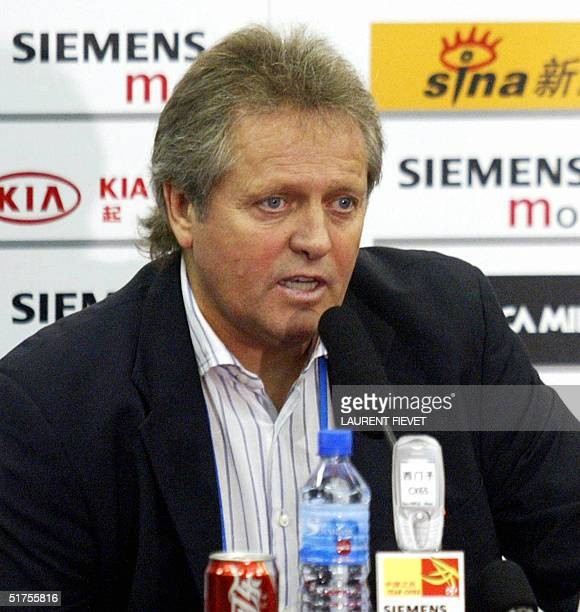China's national team football coach from Holland Arie Haan answers a journalist's question during a press conference after their 2006 World Cup...