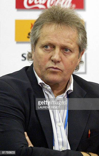 China's national team football coach from Holland Arie Haan ponders a journalist's question during a press conference after their 2006 World Cup...