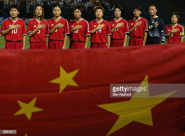 China's national team salutes the flag before the match against Russia in the first round of the FIFA Women's World Cup at the PGE Park on September...