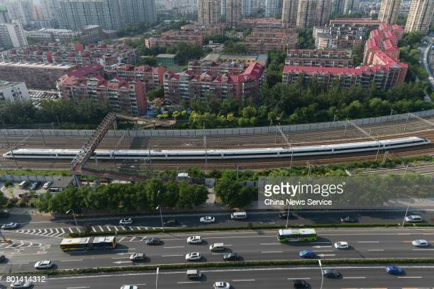 China's new high speed train 'Fuxing' arrives at Beijing South Railway Station during its first route from Shanghai to Beijing on June 26 2017 in...