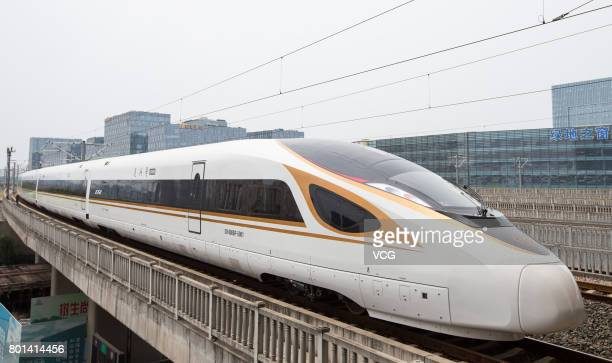 China's new high speed train 'Fuxing' leaves Nanjing South Railway Station during its first route from Shanghai to Beijing on June 26 2017 in Nanjing...