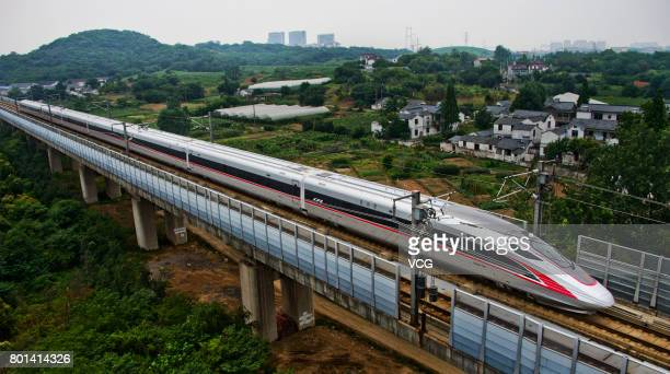 China's new high speed train 'Fuxing' travels during its first route from Beijing to Shanghai on June 26 2017 in Zhenjiang China Two new bullet...