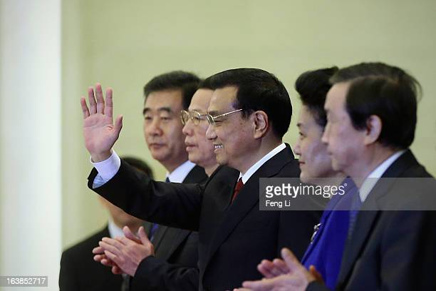 China's newlyelected Premier Li Keqiang waves as he is flanked by newlyelected vice premiers Ma Kai Zhang Gaoli Wang Yang and Liu Yandong during a...