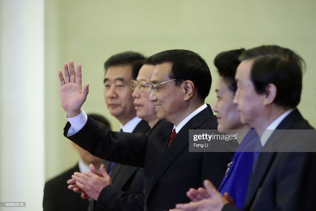 China's newly-elected Premier Li Keqiang (C) waves as he is flanked by newly-elected vice premiers Ma Kai (R), Zhang Gaoli (2nd L), Wang Yang (L) and Liu Yandong (2nd R) during a news conference after the closing session of the National People's Congress (NPC) at the Great Hall of the People on March 17, 2013 in Beijing, China. Chinese Premier Li Keqiang has vowed to tackle with mounting problems of environment pollution and food safety on Sunday.