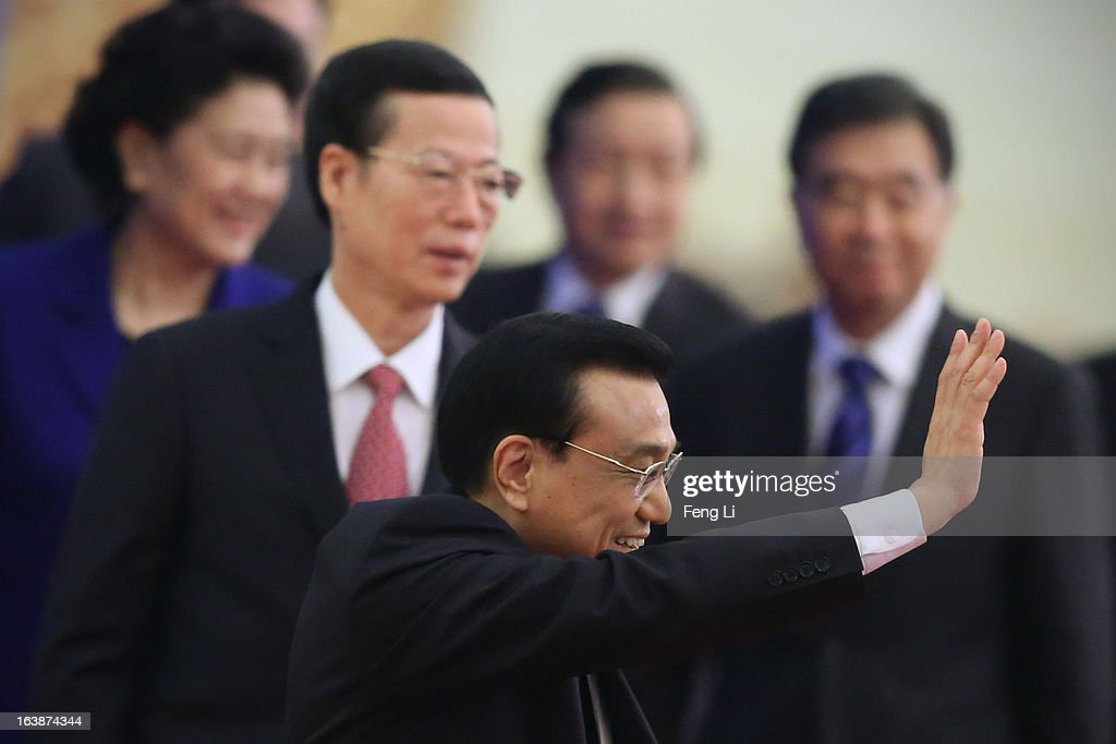 China's newly-elected Premier Li Keqiang (Bellow) waves as he is flanked by newly-elected vice premiers Ma Kai (2nd Right), Zhang Gaoli (2nd Left), Wang Yang (Right) and Liu Yandong (Left) after a news conference after the closing session of the National People's Congress (NPC) at the Great Hall of the People on March 17, 2013 in Beijing, China. Chinese Premier Li Keqiang has vowed to tackle with mounting problems of environment pollution and food safety on Sunday.