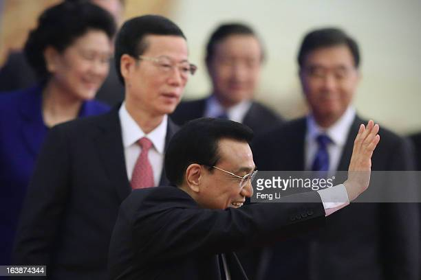 China's newlyelected Premier Li Keqiang waves as he is flanked by newlyelected vice premiers Ma Kai Zhang Gaoli Wang Yang and Liu Yandong after a...