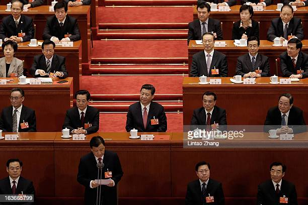 China's newlyelected President Xi Jinping attend the fourth plenary meeting of the National People's Congress at the Great Hall of the People on...