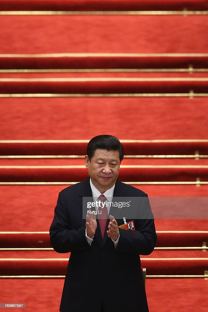 China's newly-elected President Xi Jinping attends the fourth plenary meeting of the National People's Congress at the Great Hall of the People on March 14, 2013 in Beijing, China. Xi Jinping, general secretary of the Communist Party of China Central Committee, was elected President of the People's Republic of China and Chairman of the Central Military Commission on Thursday.