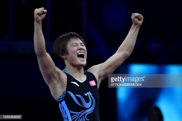 China's Ningning Rong celebrates her victory over Bulgaria's Bilyana Zhivkova Dudova after the final of women's freestyle wrestling 57kg category at...