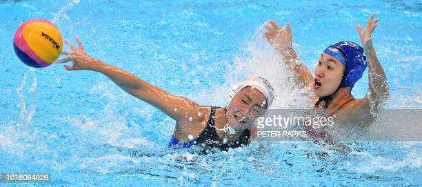 China's Niu Guannan fights for the ball with Japan's Kotori Suzuki in the womens preliminary group A water polo match between China and Japan during...