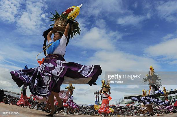 Chinas Oaxaquenas perform during the Guelaguetza of Bicentenary at the Benito Juarez Stadium on July 19 2010 in Oaxaca City Mexico