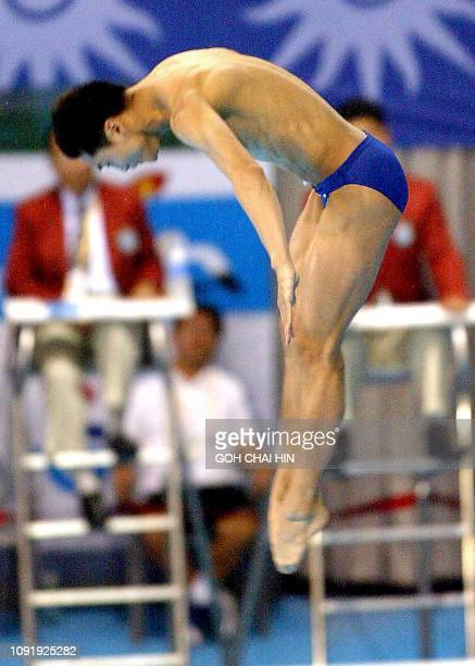 China's Olympic and world champion Tian Liang dives pass the judges in the men's 10m platform final at the 14th Asian Games in Busan 13 October 2002...