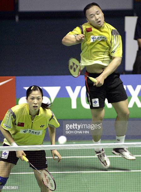 China's Olympic Games champions Zhang Jun and Gao Ling in action against South Korea's Lee Jae Jin and Lee Hyo Jung in the mixed doubles semifinal of...